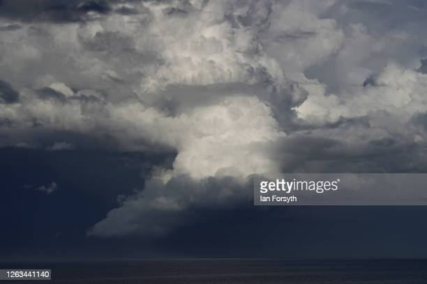 Cumulonimbus cloud formations build in the sky over the North Sea during thundery weather on August 02, 2020 in Saltburn By The Sea, England. Heavy...