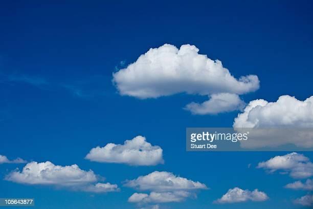 Cumulus clouds against blue sky