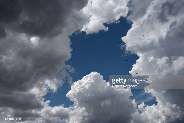 Cumulus clouds form in the sky over Santa Fe, New Mexico.