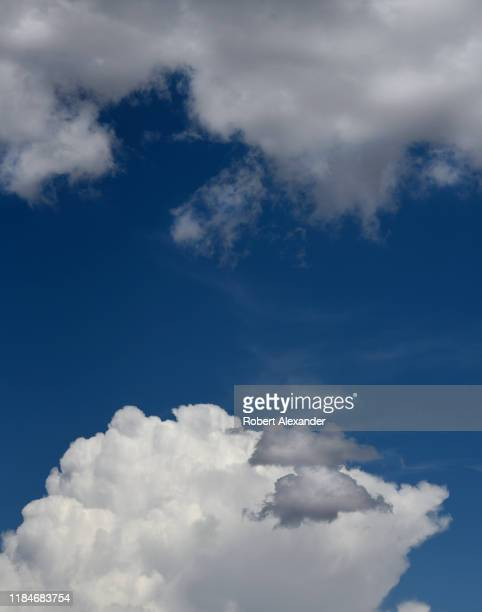 Cumulus clouds form in the sky over Santa Fe New Mexico