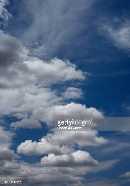 Cumulus clouds form in trhe sky over Santa Fe New Mexico