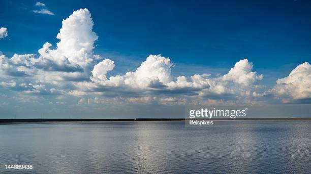 cumulus clouds in blue sky - lifeispixels stock pictures, royalty-free photos & images