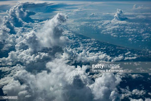 Cumulus clouds on Brunei Darussalam and South China Sea daytime aerial view from airplane