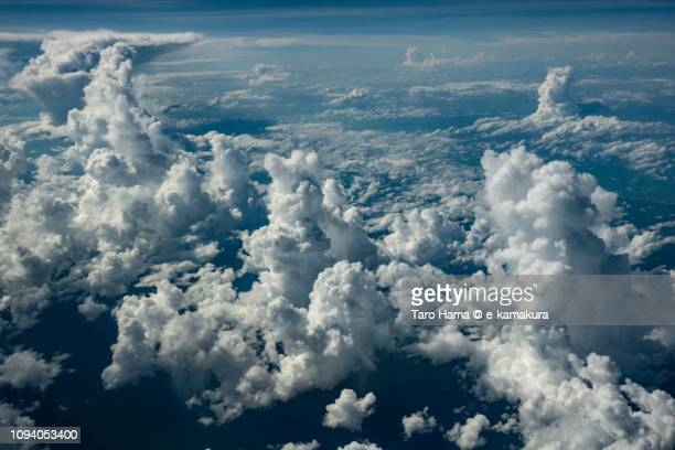 Cumulus clouds on Brunei Darussalam daytime aerial view from airplane