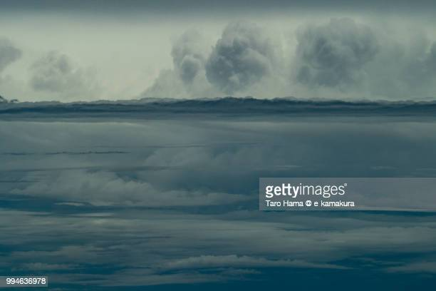 Cumulus clouds on East China Sea daytime aerial view from airplane