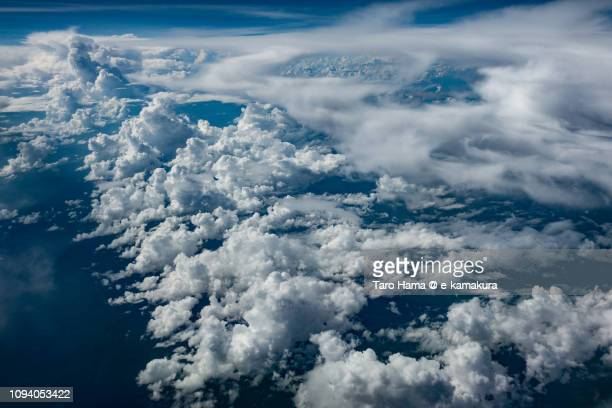 Cumulus clouds on Java sea and West Kalimantan in the island of Borneo daytime aerial view from airplane