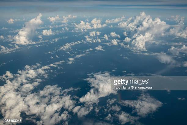Cumulus clouds on Pacific Ocean daytime aerial view from airplane