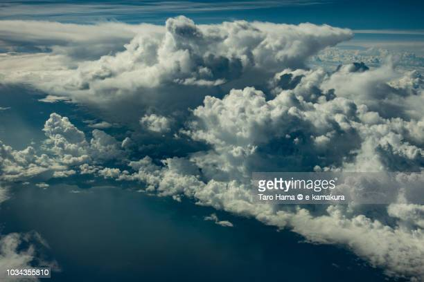 Cumulus clouds on Riau Island in Indonesia in South China Sea daytime aerial view from airplane