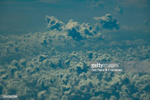 Cumulus clouds on South China Sea daytime aerial view from airplane