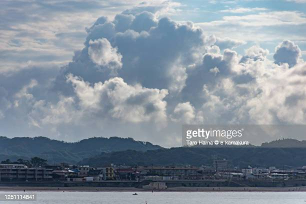 cumulus clouds on the beach in kanagawa prefecture of japan - taro hama ストックフォトと画像