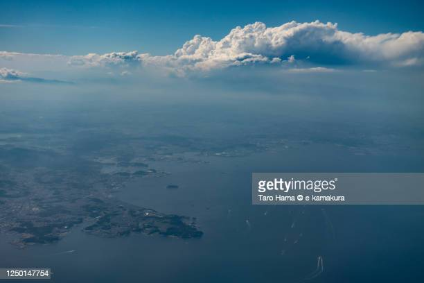 cumulus clouds on the land in kanagawa prefecture of japan - taro hama ストックフォトと画像