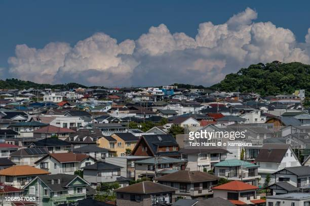 cumulus clouds on the residential district in kanagawa prefecture of japan - %e... ストックフォトと画像
