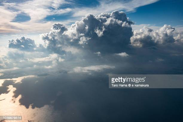 Cumulus clouds on Tokyo Bay and Yokohama city in Japan daytime aerial view from airplane