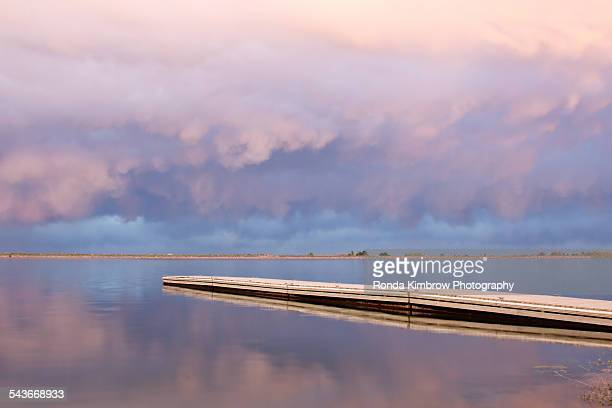 Cumulus clouds over a fishing dock