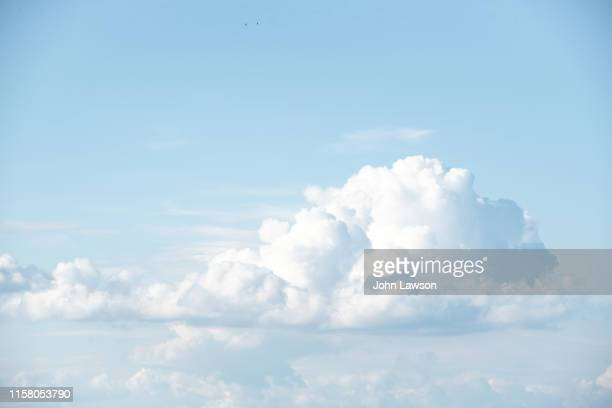 cumulus clouds - cumulus stock pictures, royalty-free photos & images