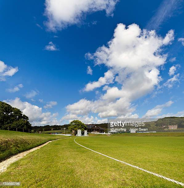 cumulus cricket field - cricket pitch stock pictures, royalty-free photos & images