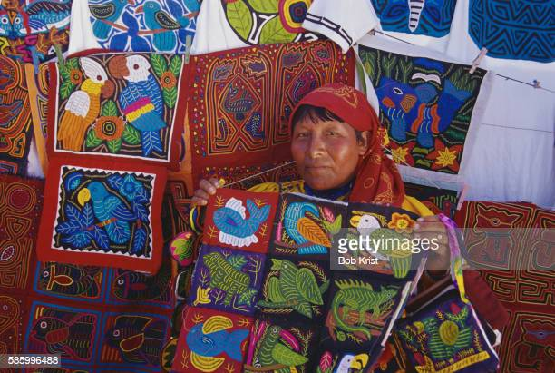 cuna woman holding molas - mola stock pictures, royalty-free photos & images