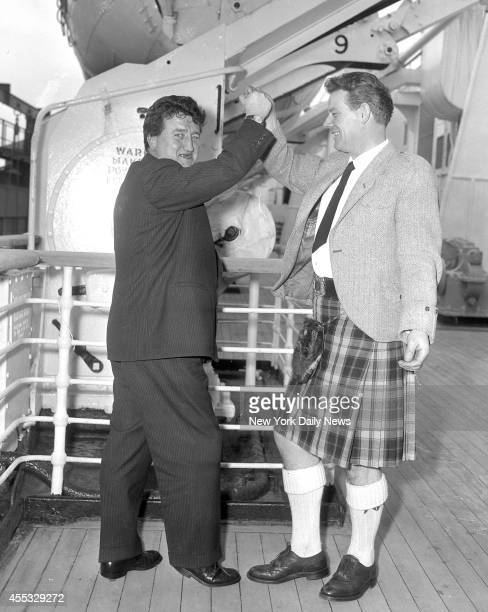 Cunard Liner Queen Elizabeth arrives at Pier 90 Brendan Behan noted Irish Playwright and his friend Dennis Clancy of Dundee Scotland Both do the...