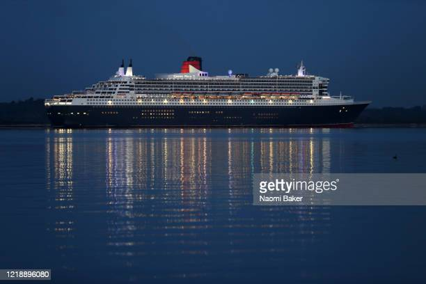 Cunard's Queen Mary 2 ocean liner arrives to the port of Southampton during the coronavirus pandemic on April 15 2020 in Southampton England Queen...