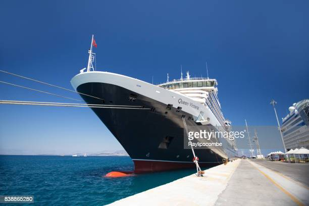 cunard's queen victoria cruise ship moored in corfu, greece on a sunny day - queen victoria stock pictures, royalty-free photos & images
