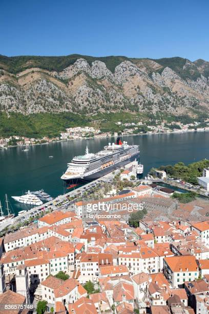 cunards, 'queen victoria' cruise ship moored up in the bay of kotor in montenegro on a clear summers morning - queen victoria stock pictures, royalty-free photos & images