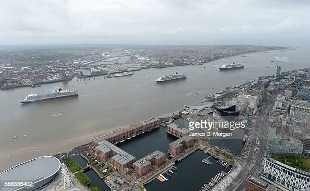 Cunard's three Queens dance in the river Mersey on May 26 2015 in Liverpool England Queen Mary 2 Queen Victoria and Queen Elizabeth met for a...