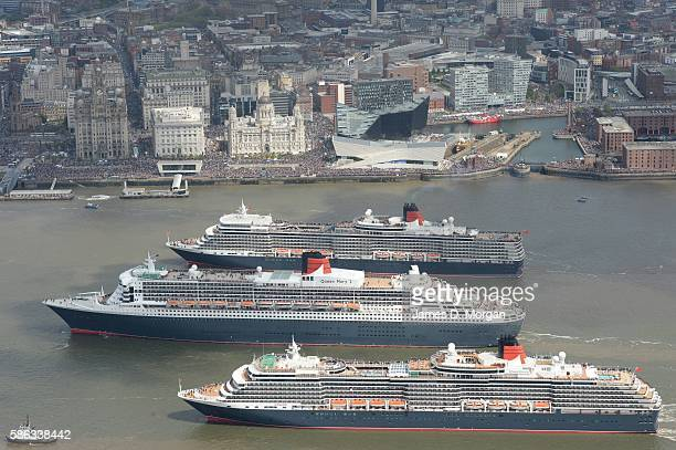 Cunard's three Queens dance in the river Mersey on May 26, 2015 in Liverpool, England. Queen Mary 2, Queen Victoria and Queen Elizabeth met for a...