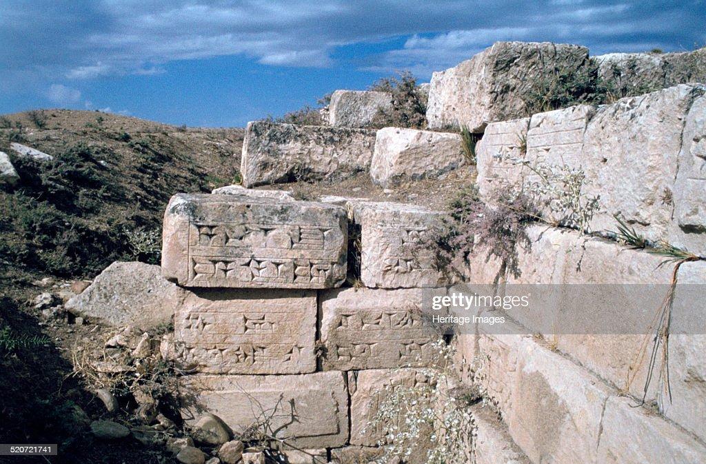 Cuneiform inscriptions on stones, ruined aqueduct, Jerwan, Iraq, 1977. : News Photo