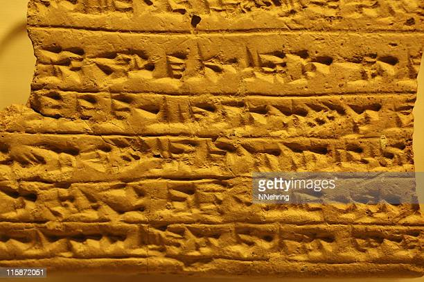 cuneiform on clay tablet - mesopotamian stock photos and pictures