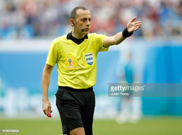 Cuneyt Cakir referee gives a decision during the 2018 FIFA World Cup Russia group B match between Morocco and Iran at Saint Petersburg Stadium on...