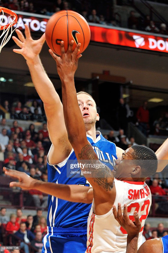 D.J. Cunningham #33 of the UNC Asheville Bulldogs blocks a shot from Lenzelle Smith, Jr. #32 of the Ohio State Buckeyes in the first half on December 15, 2012 at Value City Arena in Columbus, Ohio. Ohio State defeated UNC Asheville 90-72.
