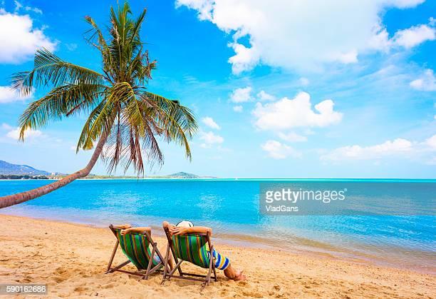 Cuople sitting at beach chair
