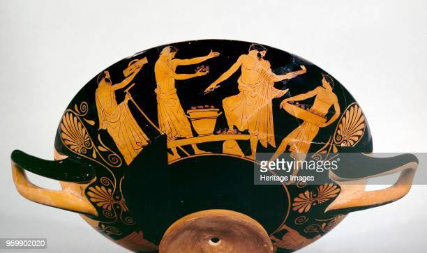 Cup 470460BC Athenian redfigure cup bearded male and a slave youths the sacrificial scenes have never been satisfactorily explained on one side...
