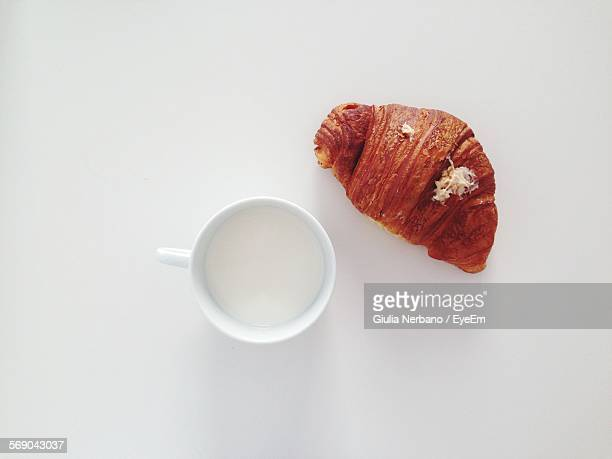 Cup And Croissant Over White Background