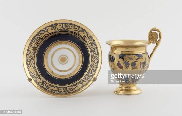 Cup and Saucer. C. 1820. Denuelle Porcelain Manufactory . France. Paris. Paris. Hard-paste porcelain. Polychrome enamels. And gilding. Cup: 11 cm ....