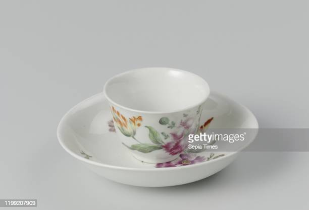 Cup and saucer Cup and saucer Cup without ear and saucer painted in purple with a flower bouquet and loose flowers among others forgetmenot Cup...