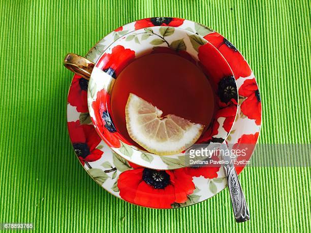 Cup And Saucer Of Lemon Tea With Teaspoon