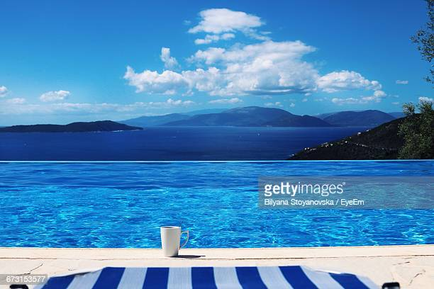 cup at poolside against sky - poolside stock pictures, royalty-free photos & images