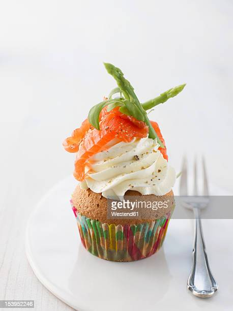 Cup cake with cream cheese, wild asparagus, salmon and black pepper on plate