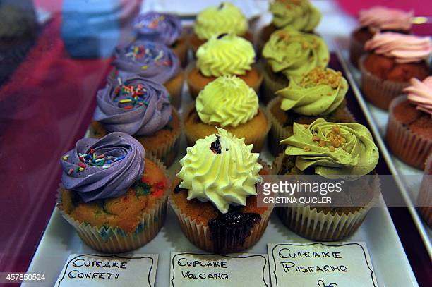 Cup cakes are exposed during the Sevilla creative pastry sweet fare at Fibes in Sevilla on October 25 2014 AFP PHOTO/ CRISTINA QUICLER
