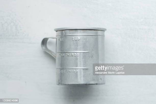 cup can with measurements on a roughly painted white background - enamel stock pictures, royalty-free photos & images