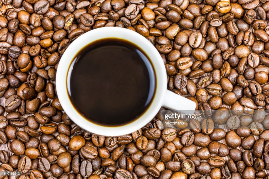 Cup coffee with coffee beans : Stock Photo