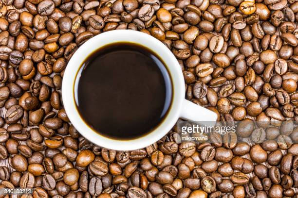 cup coffee with coffee beans - coffee stock photos and pictures