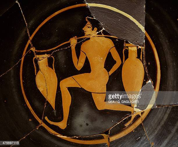 Cup depicting a young man carrying two amphora attributed to the Painter of the Agora redfigure pottery Greek civilisation 5th century BC Athens...