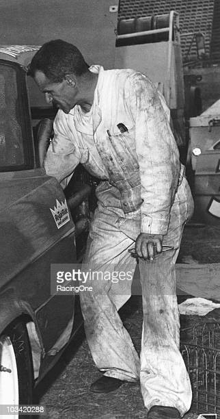 Cup driver Wendell Scott works on his Ford in the pits at a Cup race. Scott had 17 top-10 finishes during the year and took sixth in Cup points.