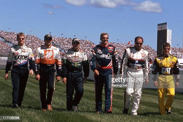 Cup drivers Jeff Burton Tony Stewart Bobby Labonte Dale Jarrett Dale Earnhardt and Ward Burton walk to their cars following driver introductions...