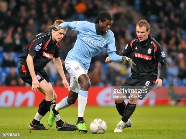 FA Cup Fifth Round Manchester City v Stoke City City of Manchester Stadium Manchester City's Emmanuel Adebayor takes on Stoke City's Glenn Whelan and...