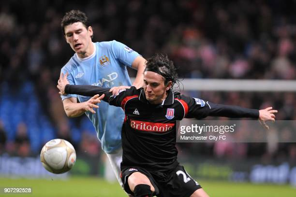FA Cup Fifth Round Manchester City v Stoke City City of Manchester Stadium Stoke City's Tuncay Sanli and Manchester City's Gareth Barry battle for...