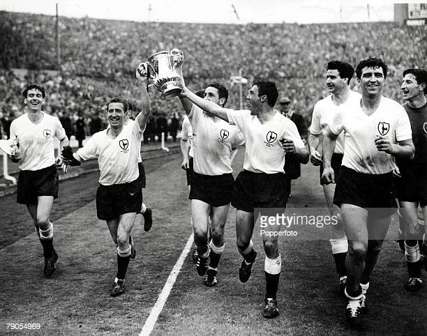 FA Cup Final 1962 SPURS v BURNLEY Spurs team runs lap of honour after being presented with the Cup by Queen Elizabeth Players Ron Henry Cliff Jones...