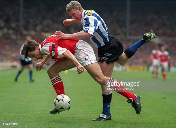 Cup Final Arsenal v Sheffield Wednesday Alan Smith shields the ball from Nigel Worthington of Wednesday